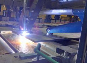 mechanized plasma cut of an extremely hot steel slab